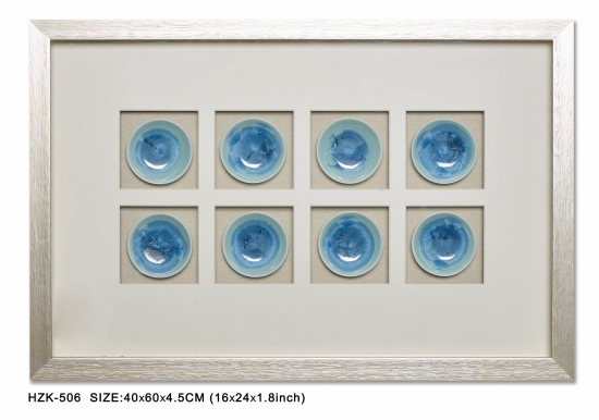 Ceramics shadow box with silver frame with texture